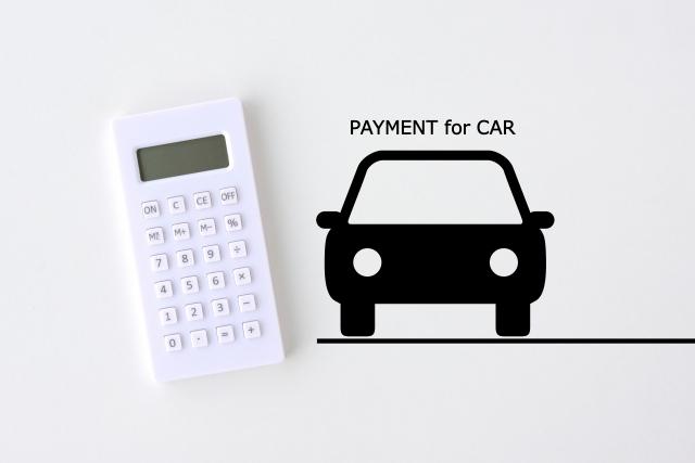 車のシルエットと電卓